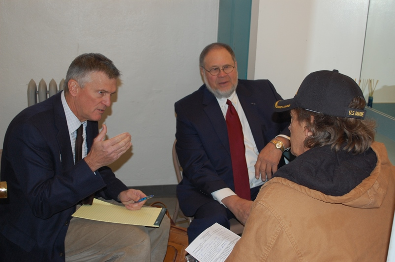 Volunteer attorneys Matt Keenan, John Solbach meeting with a Veteran